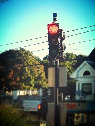 This is an actual red light near my house. It smiles at me.