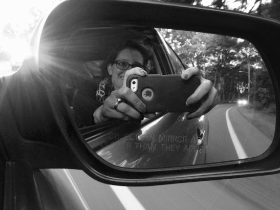 Enjoying a car ride.